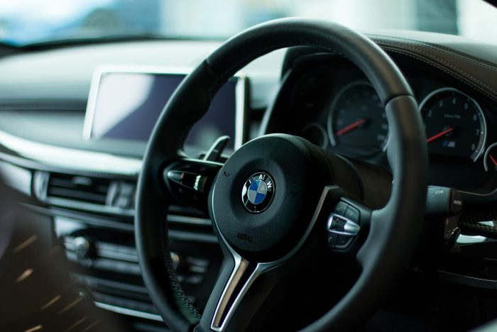 The steering wheel of a BMW car