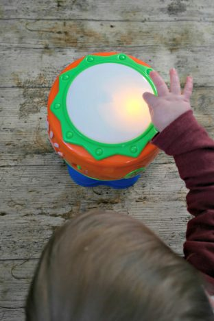 1st Birthday Gift Guide   Little Tikes Spin n Hit Drum being hit by Piglet http://oddhogg.com