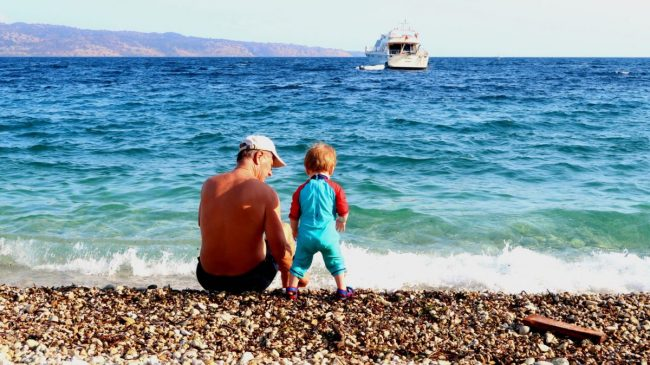 Family Trip TO Corfu | Grandad and Piglet on the beach https://oddhogg.com