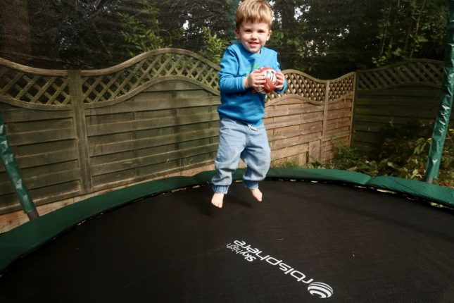 5 Ideas For Helping Your Toddler Get To Sleep | Jumping on the trampoline https://oddhogg.com