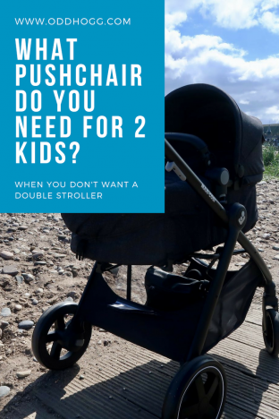 What Pushchair Do You Need For 2 Kids? | Black pram next to the beach www.oddhogg.com
