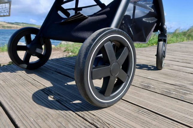 Maxi-Cosi Zelia Review | The wheels of a pushchair next to the beach www.oddhogg.com