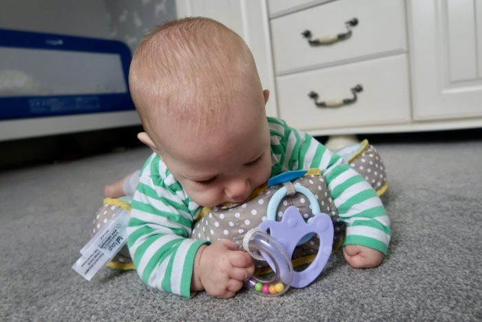 Taf Toys Developmental Pillow Review | Playing with the teether www.oddhogg.com