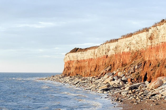 Things To Do In Norfolk: Hunstanton Beach. The sea with orange cliffs