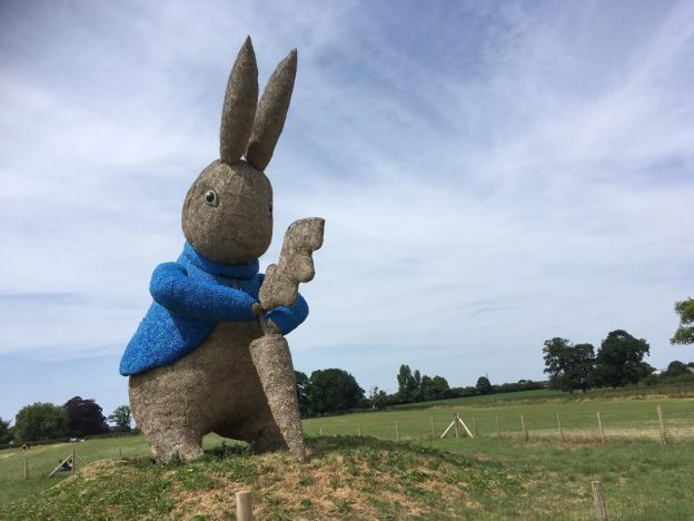 A large Peter Rabbit pulling a carrot out of the ground at Snugburys in Cheshire