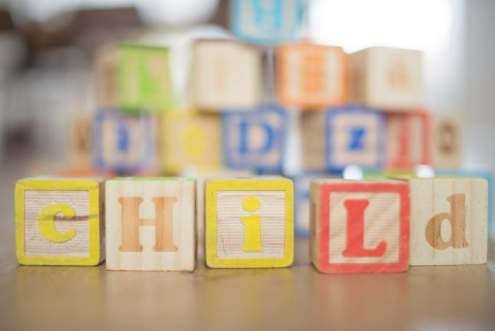 "Wooden children's building blocks spelling out ""child"""