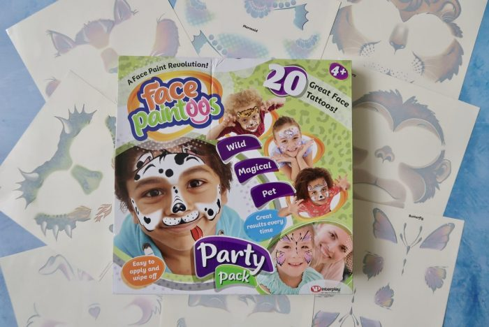 A box of face paintoos surrounded by lots of different face paint designs