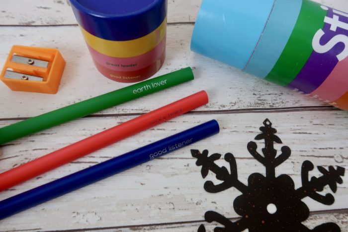 3 colouring pencils, a sharpener, a brightly coloured tube and a metal snowflake
