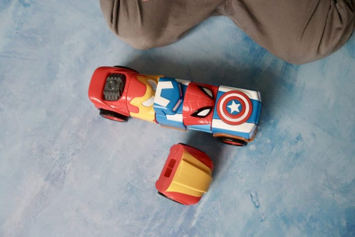 A car made up of different parts with super hero designs on them