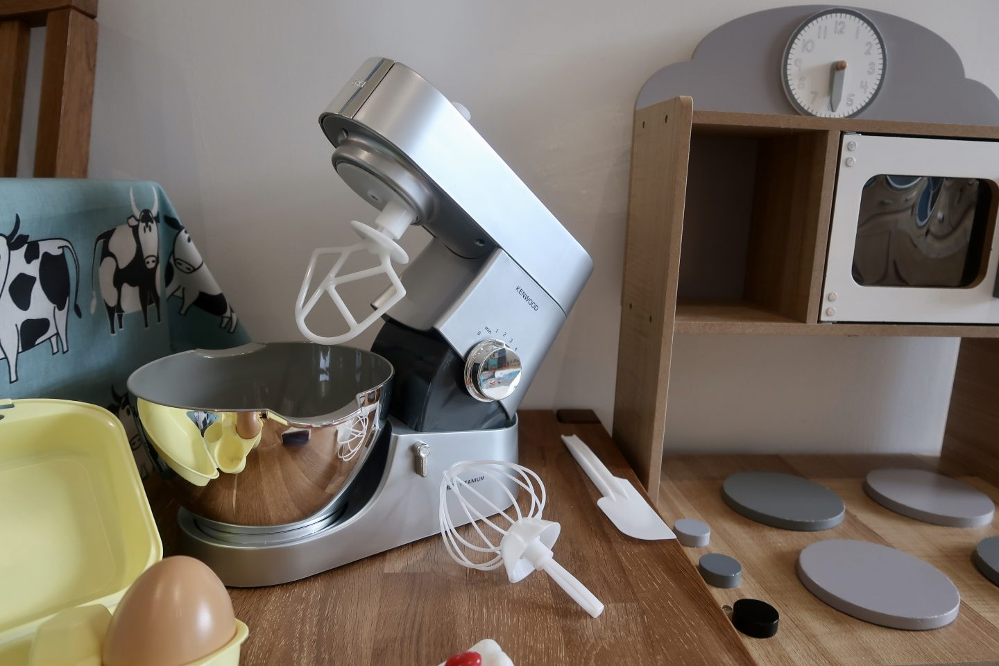 Toy food mixer in silver, surrounded by accessories