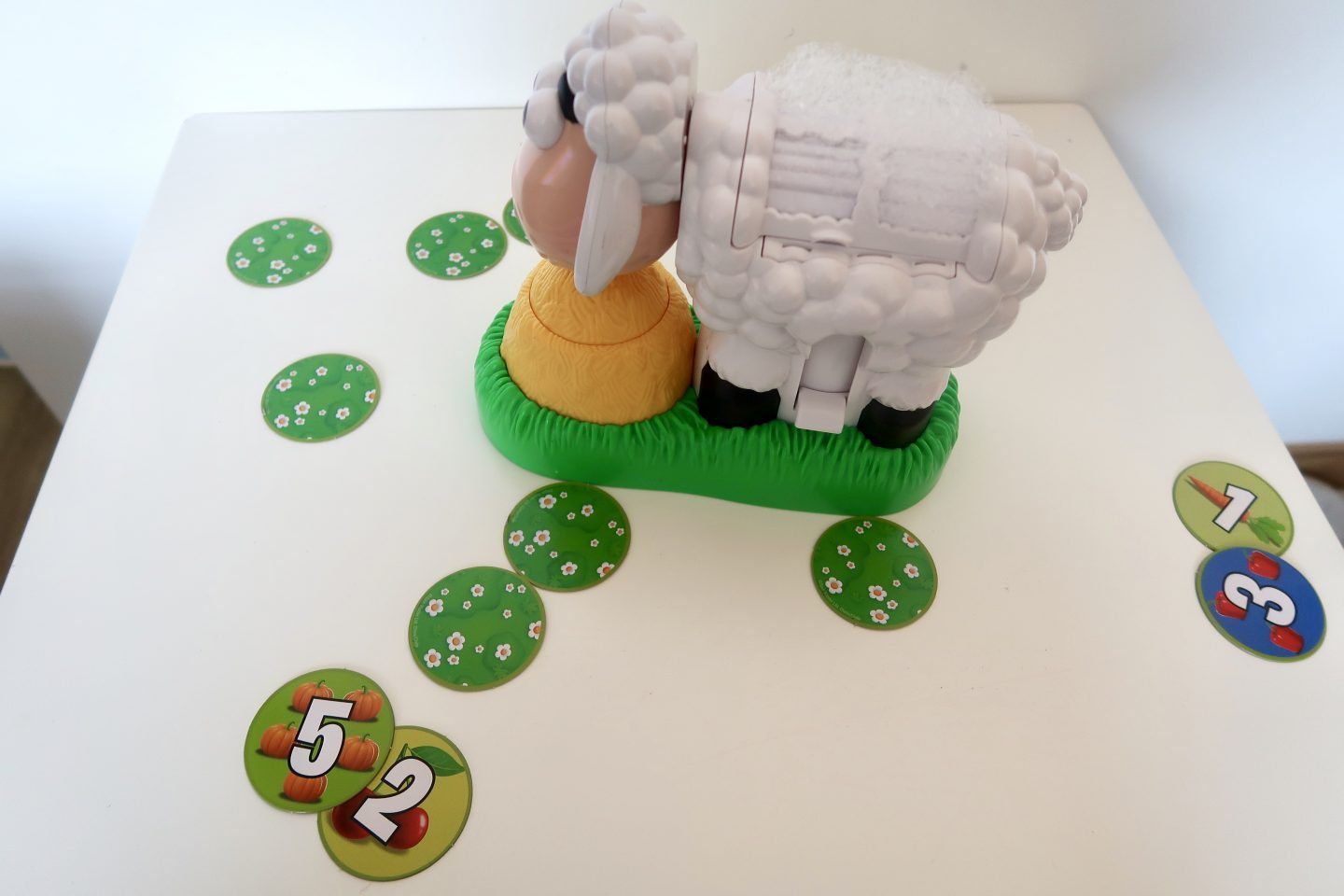 BaaBaa Bubbles sheep surrounded by green tiles, plus some tiles turned over each with a number on them
