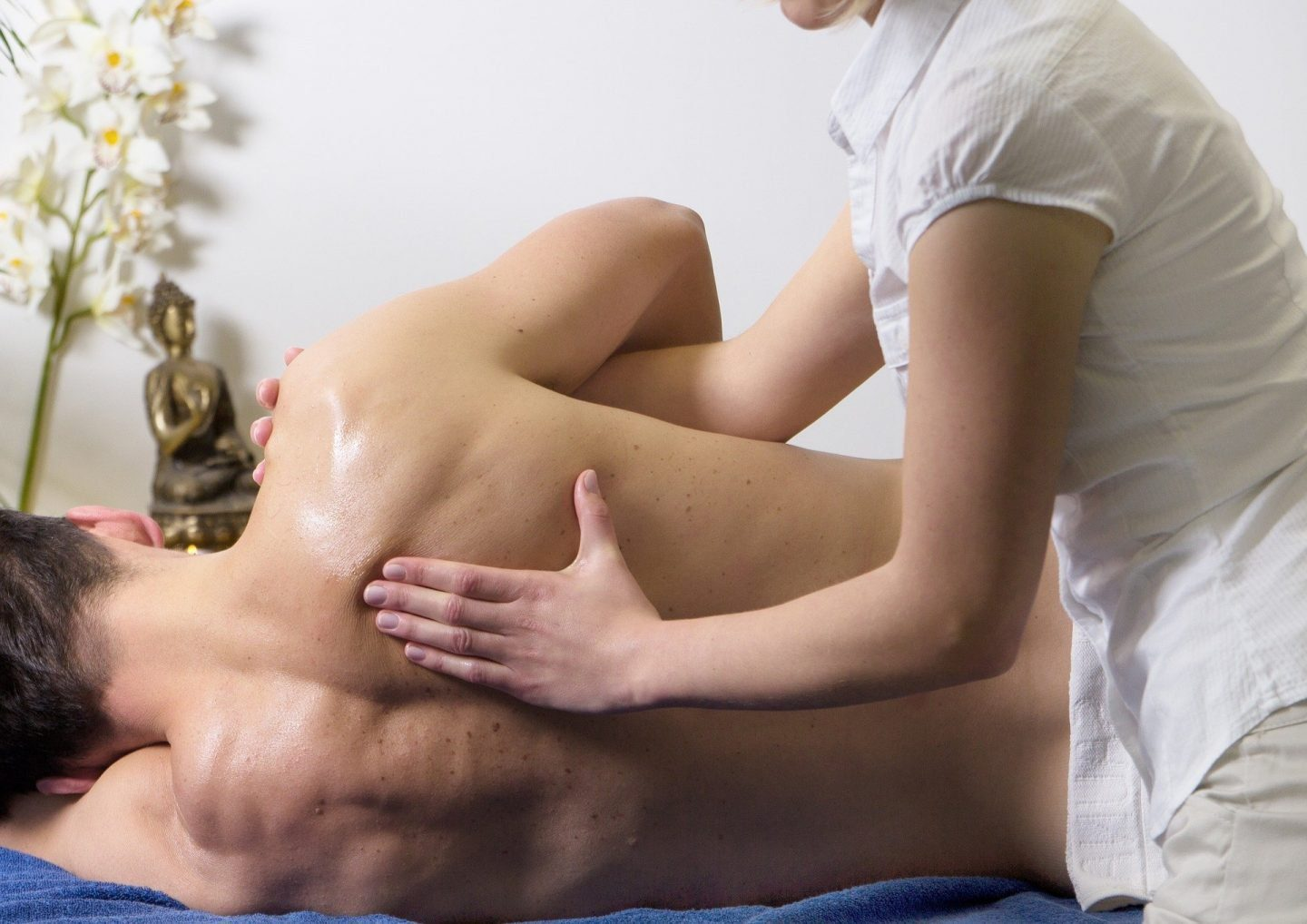 A man on his side receiving a massage on his back