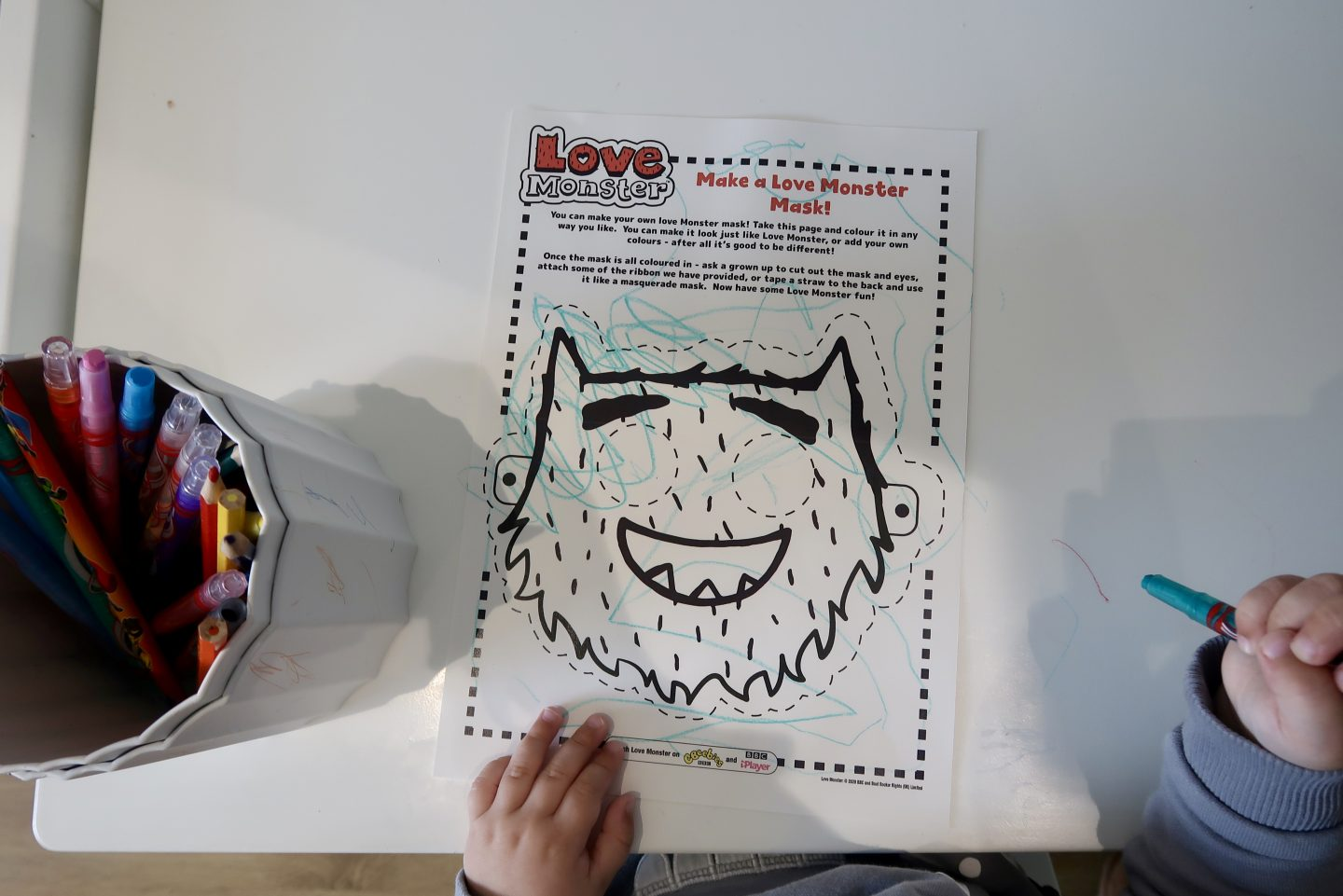 A colouring in sheet of Love Monster