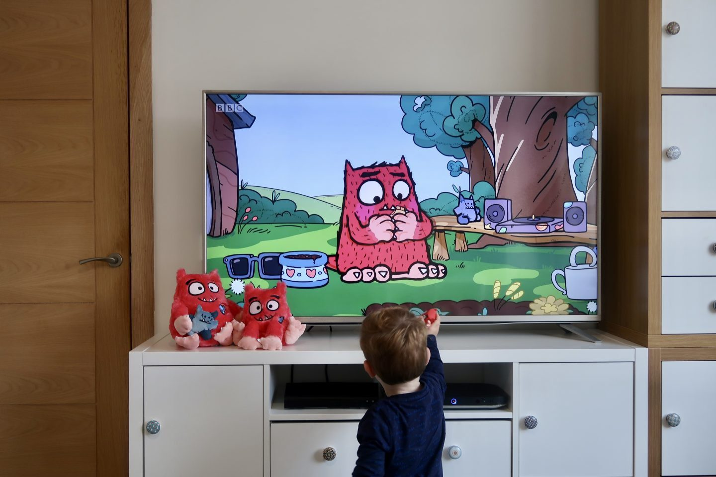 A TV playing Love Monster, with a little boy standing in front of it