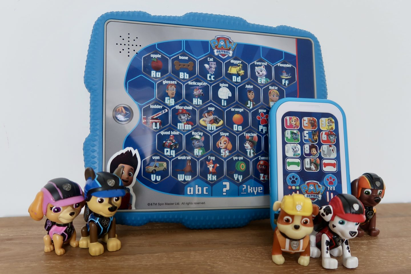 Paw Patrol Smart Phone And Ryder's Alphabet Tablet with some of the pups