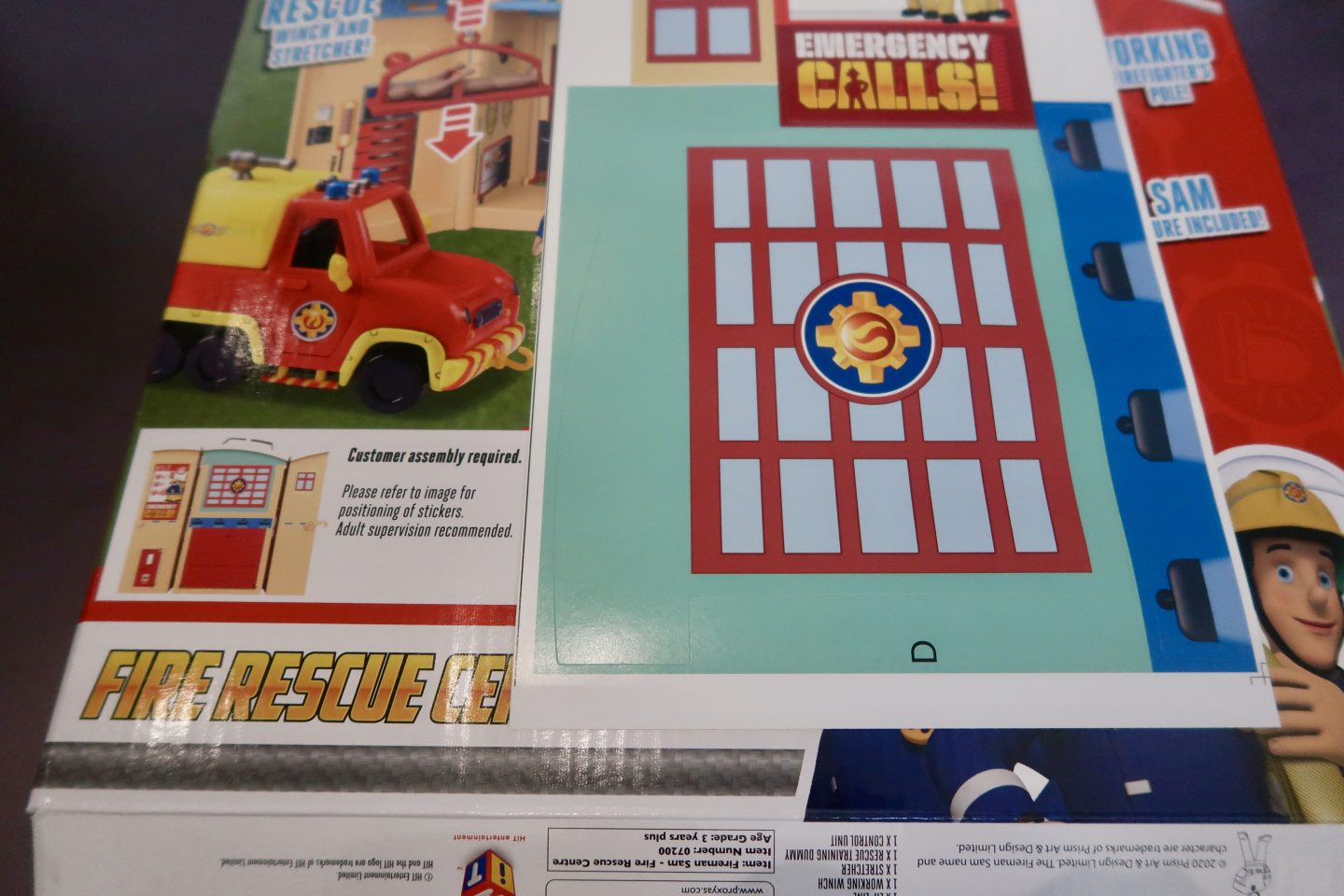 The stickers from a Fireman Sam play-set that need to be put in place.
