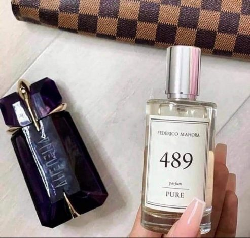 A bottle of Theirry Mugler, Alien perfume and a bottle of FM 489
