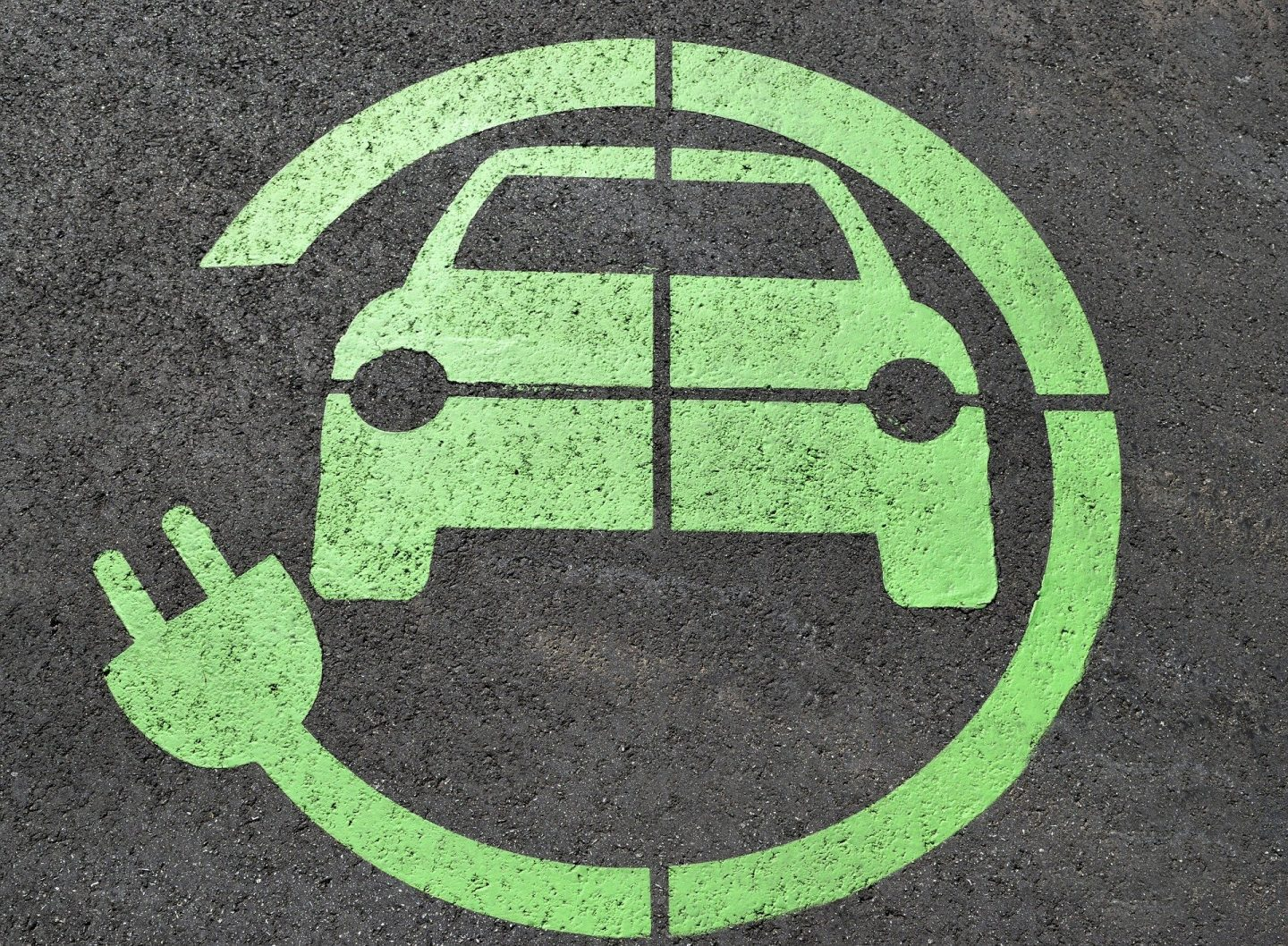 An electric car charging symbol in green