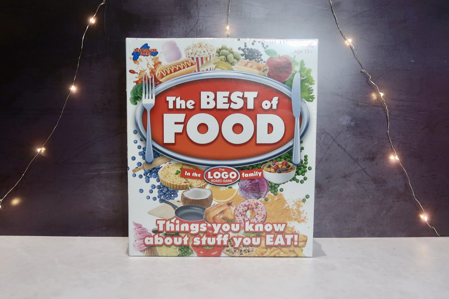 "A board game box with ""The Best Of Food"" written on it and pictures of food"