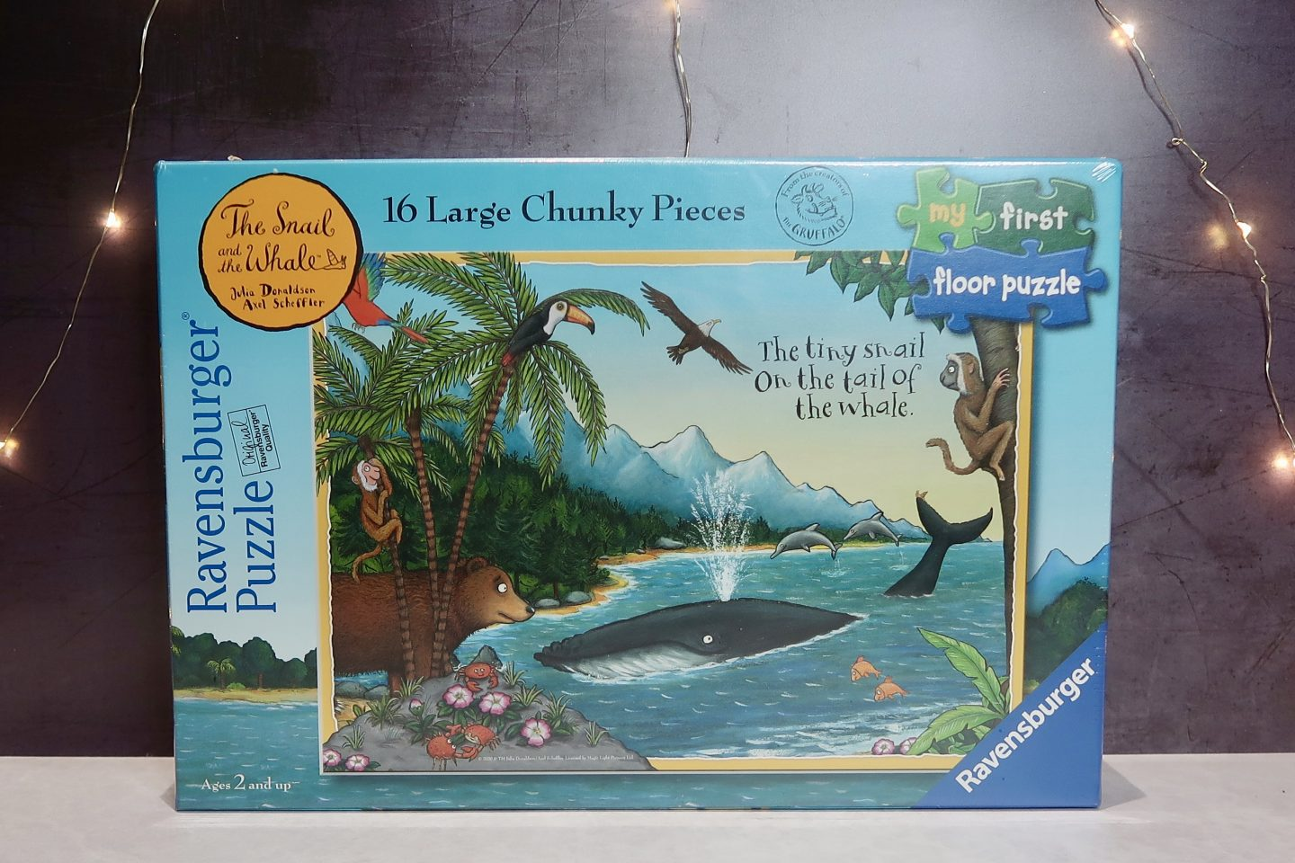 A boxed jigsaw, with a picture of a cartoon whale in an ocean on it