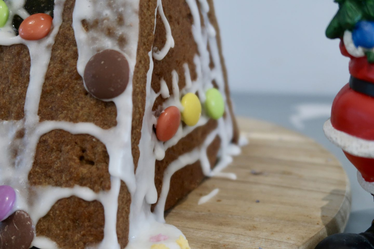The side of a gingerbread house decorated with smarties