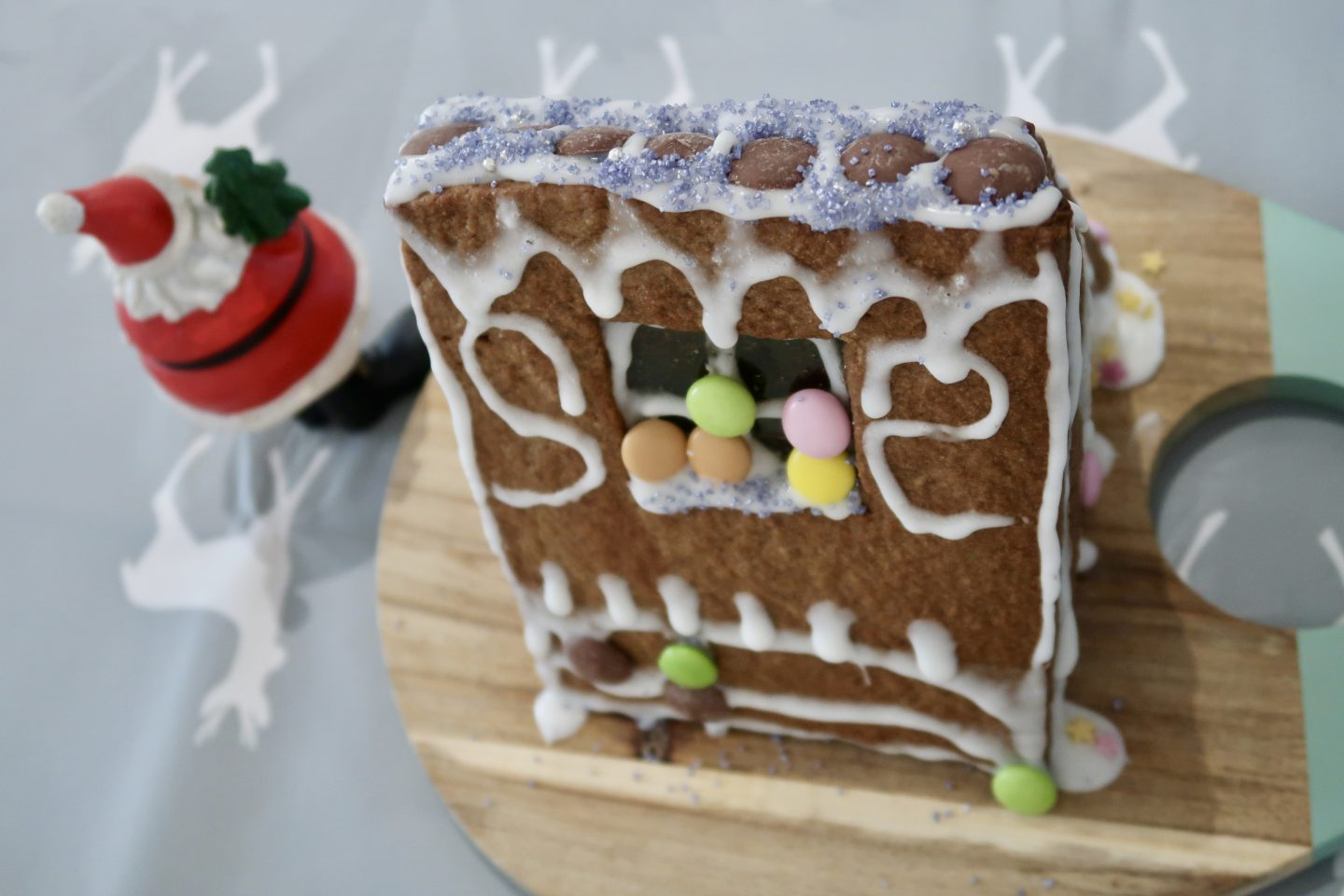 The back of a gingerbread house on a wooden board