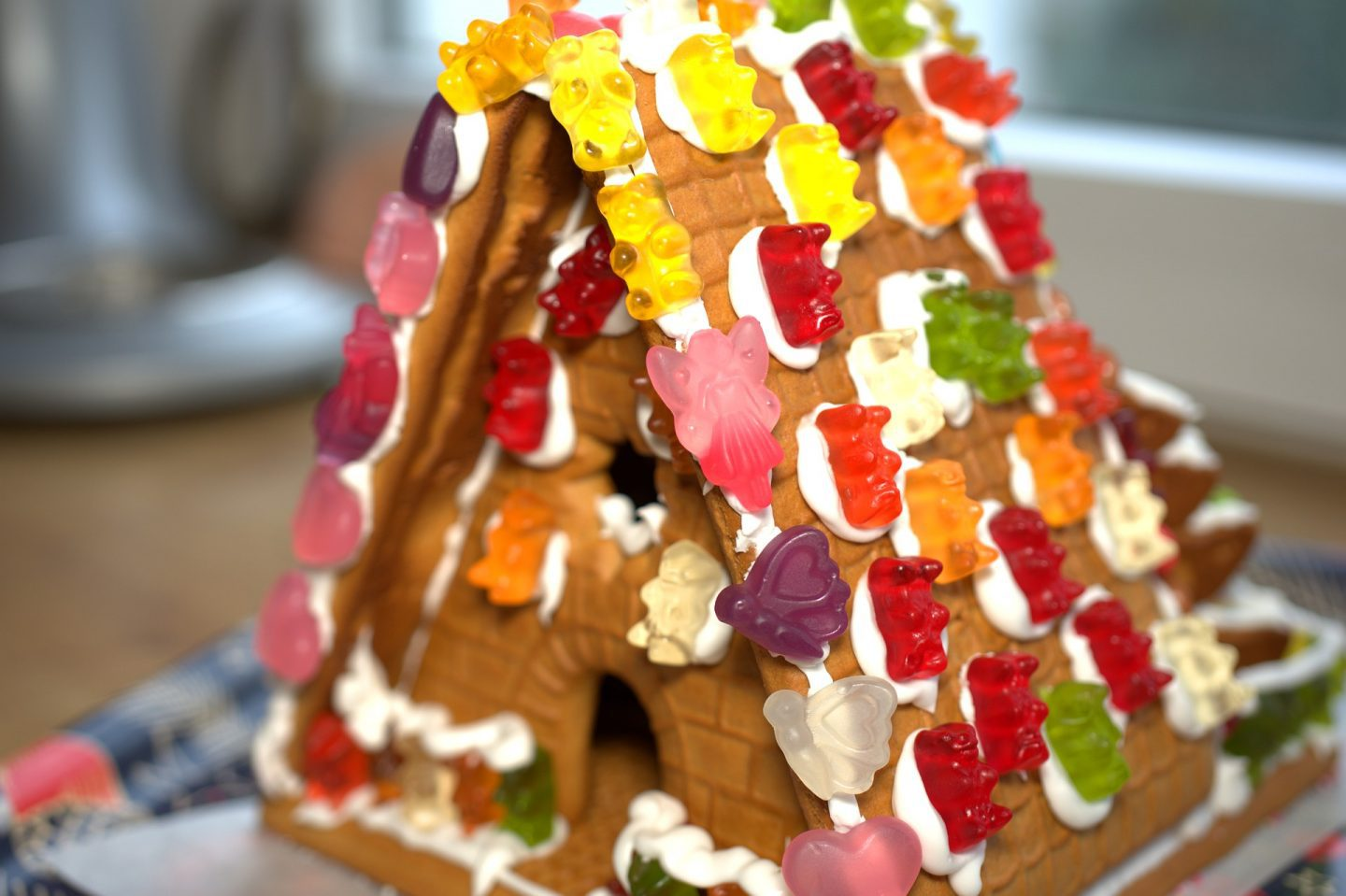 A gingerbread house covered in gummy sweets