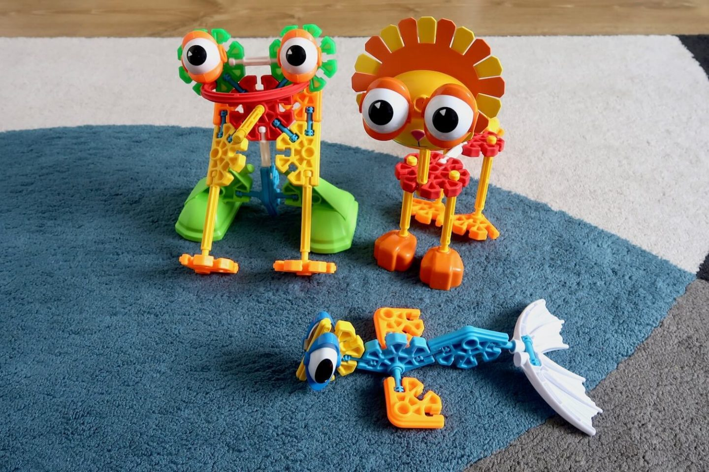 3 animals made out of Kid K'nex. A frog, a lion and a sea monster